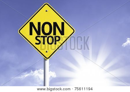 Non Stop road sign with sun background