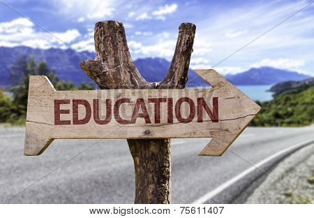 Education wooden sign with a street background