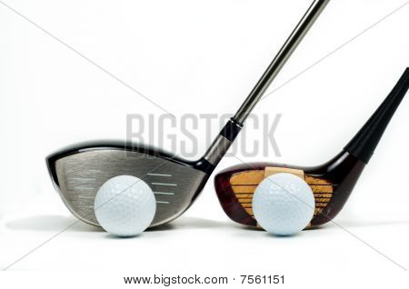 Old And New Golf Drivers Beside One Another