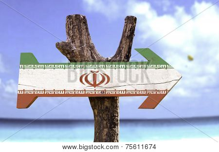 Iran sign with a beach on background