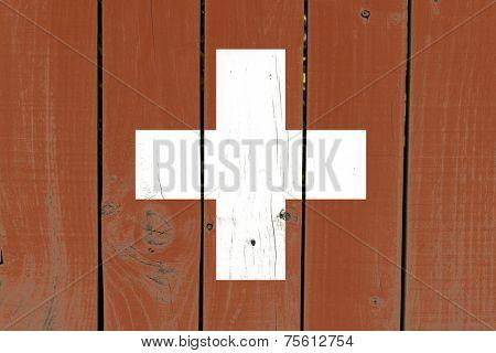Switzerland flag on wooden background