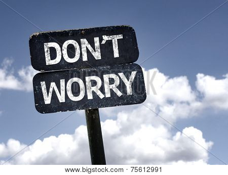 Don't Worry sign with clouds and sky background