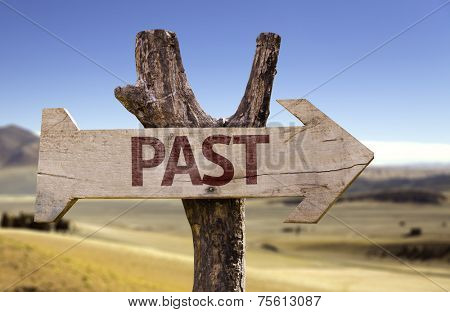 Past wooden sign with a desert background