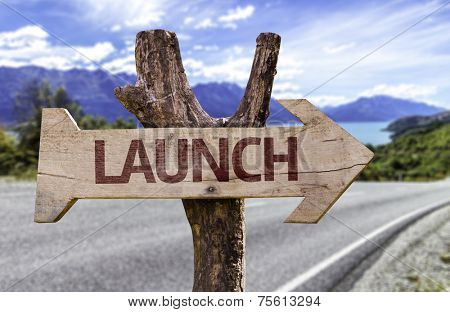 Launch wooden sign with a street background