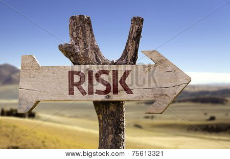 Risk wooden sign with a desert background