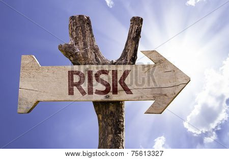 Risk sign with a beautiful day on background