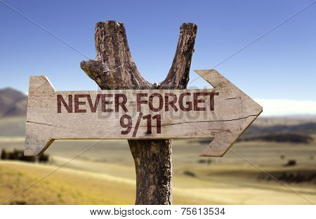 Never Forget 9/11 wooden sign on desert background