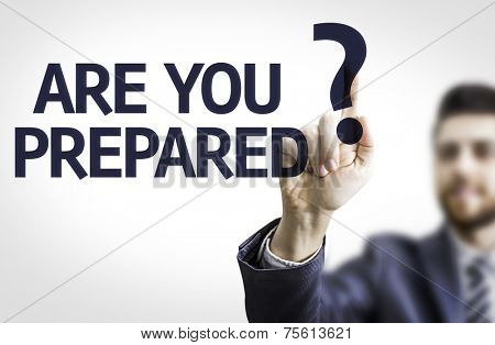 Business man pointing to transparent board with text: Are you Prepared?