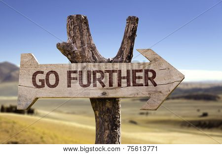 Go Further wooden sign with a desert background