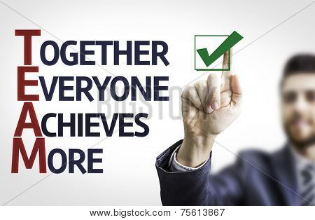 Business man pointing to transparent board with text: Together Everyone Achieves More