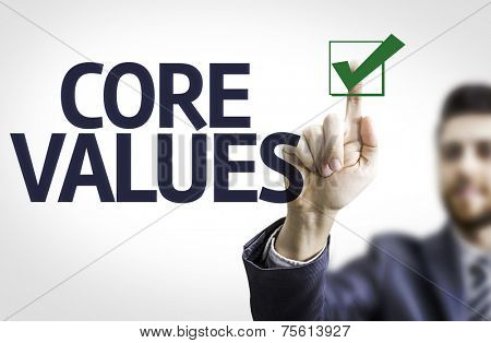 Business man pointing to transparent board with text: Core Values