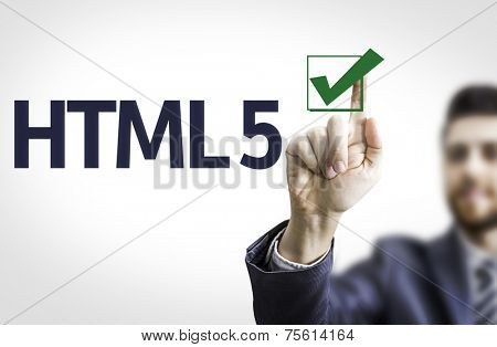 Business man pointing to transparent board with text: HTML 5