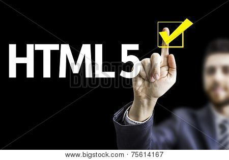 Business man pointing to black board with text: HTML 5