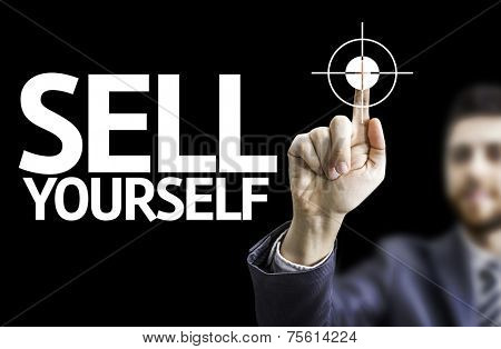 Business man pointing to black board with text: Sell Yourself