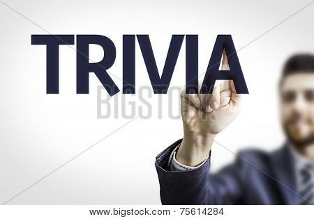 Business man pointing to transparent board with text: Trivia