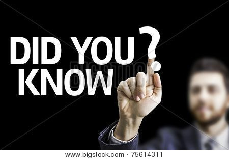 Business man pointing to black board with text:  Did you Know?