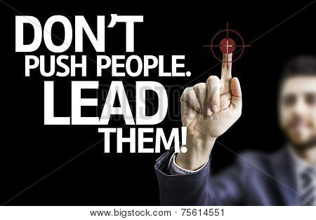Business man pointing to black board with text: Don't Push People, Lead Them!
