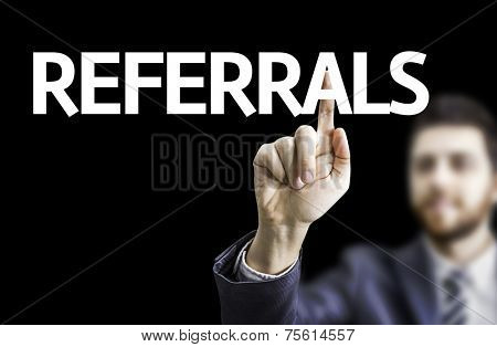 Business man pointing to black board with text: Referrals