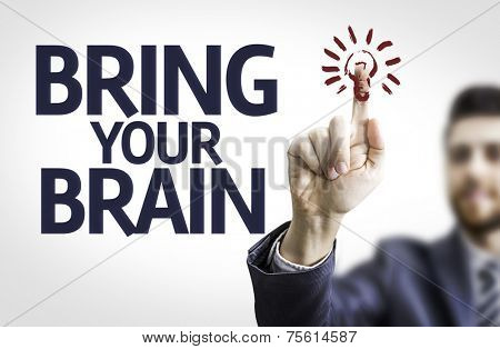 Business man pointing to transparent board with text: Bring your Brain
