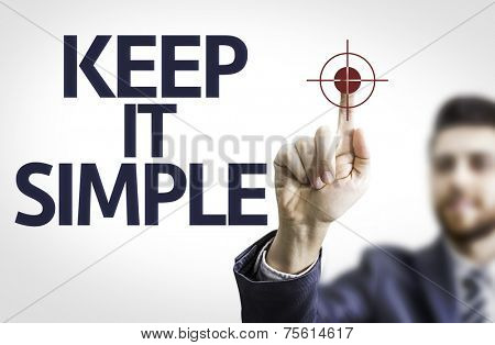 Business man pointing to transparent board with text: Keep It Simple