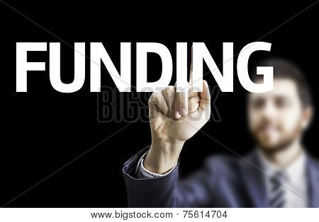 Business man pointing to black board with text: Funding