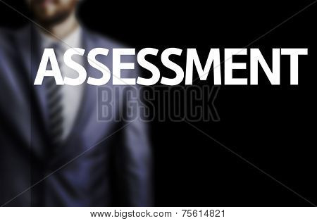 Assessment written on a board with a business man on background