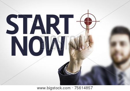 Business man pointing to transparent board with text: Start Now