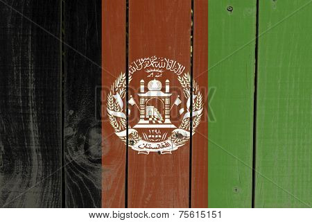 Afghanistan flag on wooden background