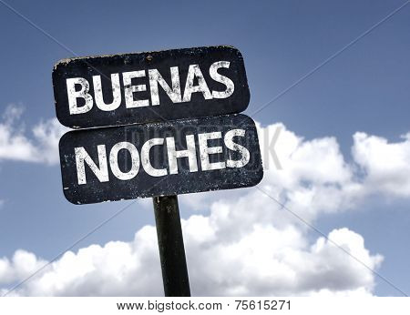 Good Night (In Spanish) sign with clouds and sky background