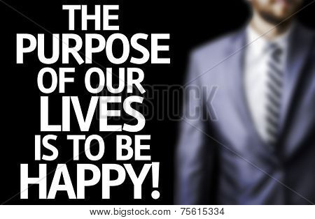 The Purpose of Our Lives is To Be Happy written on a board with a business man on background