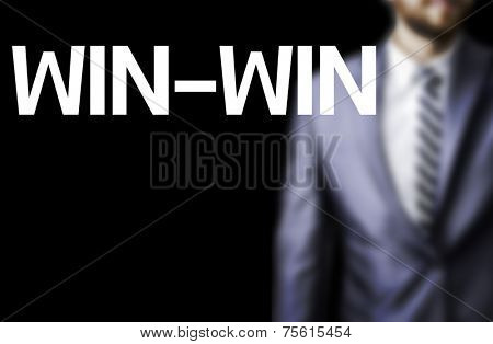 Win-Win written on a board with a business man on background