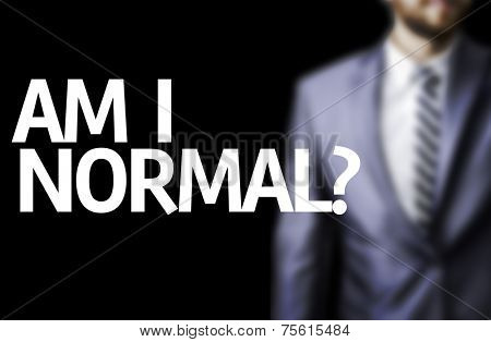 Am I Normal? written on a board with a business man on background