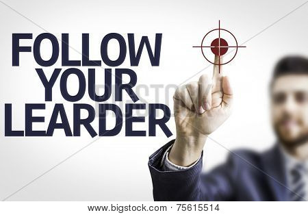 Business man pointing to transparent board with text: Follow your Leader