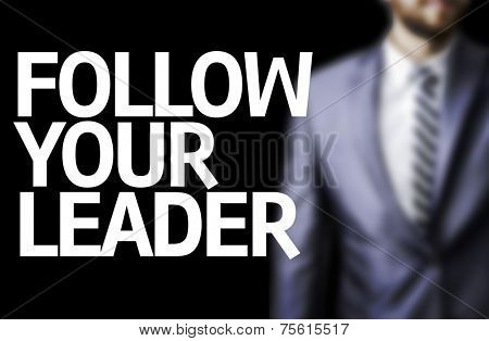 Follow your Leader written on a board with a business man on background