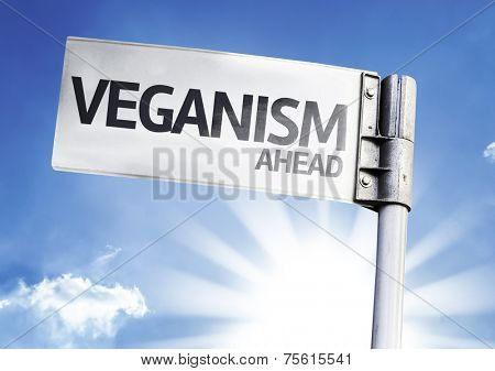 Veganism Ahead written on the road sign
