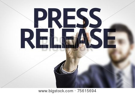 Business man pointing to transparent board with text: Press Release