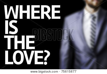 Where is the Love? written on a board with a business man on background