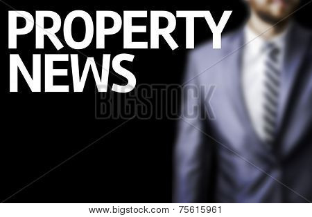 Property News written on a board with a business man on background