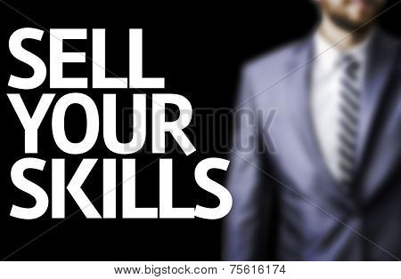 Sell Your Skills written on a board with a business man on background