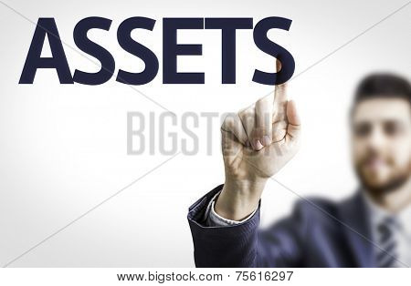 Business man pointing to transparent board with text: Assets