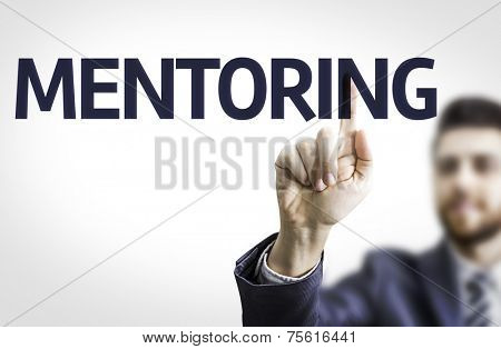 Business man pointing to transparent board with text: Mentoring