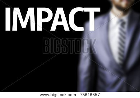 Impact written on a board with a business man on background