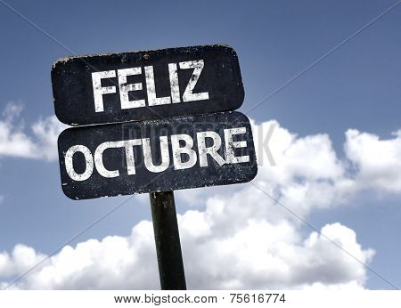 Happy October (In Spanish) sign with clouds and sky background