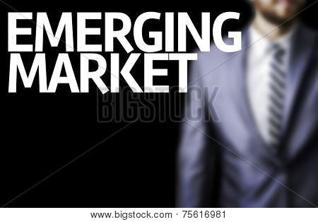 Emerging Market written on a board with a business man on background