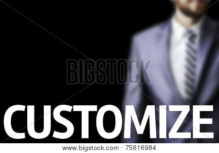Customize written on a board with a business man on background