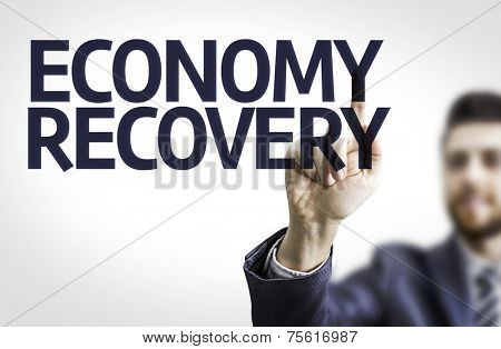 Business man pointing to transparent board with text: Economy Recovery
