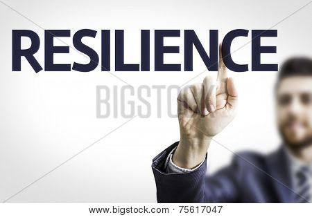Business man pointing to transparent board with text: Resilience