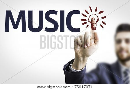 Business man pointing to transparent board with text: Music