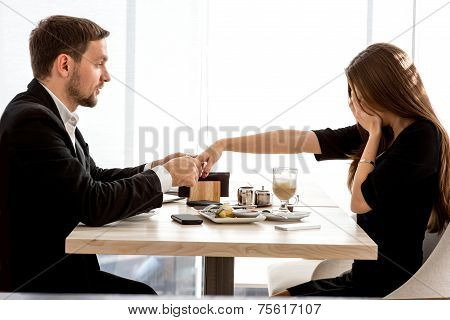 Man making proposal to his girlfriend at the restaurant