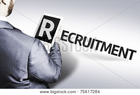 Business man with the text Recruitment in a concept image